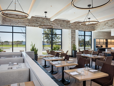 Open, airy seating inside Wolfgang Puck Kitchen + Bar