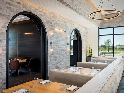 Two arched windows inside Wolfgang Puck Kitchen + Bar