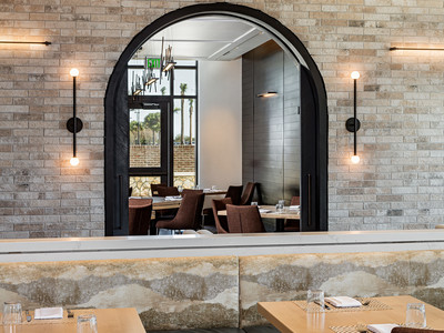 An arched window inside Wolfgang Puck Kitchen + Bar